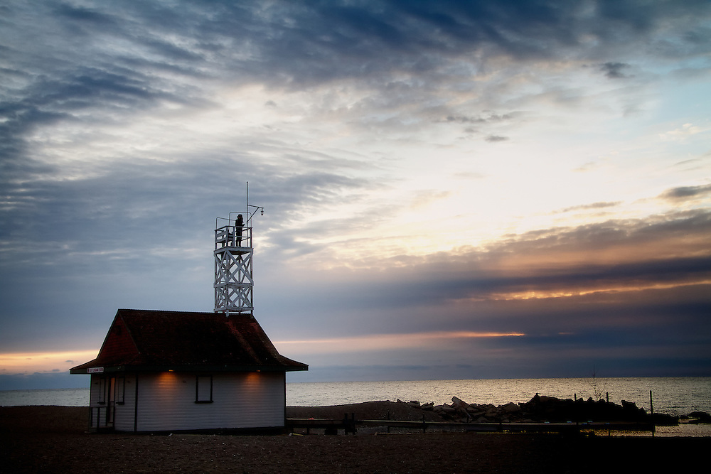 The Leuty Lifesaving Station, early dawn. Since it was built in 1920 by Chapman and Oxley architects, the Leuty Lifeguard Station has helped to save thousands of lives. Over the years it has been moved four times to keep it close to Lake Ontario's edge. During the 1980's the Leuty had fallen into disrepair and was threatened with demolition. Local residents formed S.O.S. (Save Our Station), and enough money was raised to restore the structure. It has since been declared an important historic site by the Toronto (Canada) Historical Board.<br /> <br /> + Exposure f/8 @ 1/160<br /> + Time 7:57A<br /> + Edition Size 150 Limited; 25 Artist Proof