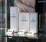 Close up of priced Chanel Number 5 perfume products, UK