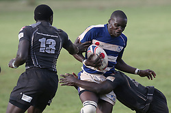 Isaac Mwaura (C) of Mean Machine in action against Mwamba RFU during their Kenya Cup Tournament at Railway Club In Nairobi, on 3rd December 2016. Mwamba won 51-8. Photo/Fredrick Onyango/www.pic-centre.com (KEN)