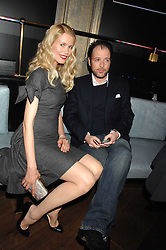 CLAUDIA SCHIFFER and MATTHEW VAUGHN at a party to launch the Dom Perignon OEotheque 1995 held at The Landau, Portland Place, London W1 on 26th February 2008.<br />