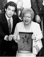 1982 Bobby Darin's mother and son, Dodd, hold the plaque during Bobby Darin's posthumous Walk of Fame ceremony
