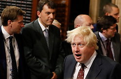 Foreign Secretary Boris Johnson walks through the Palace of Westminster to the House of Lords to attend the State Opening of Parliament in London