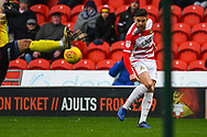 Danny Andrew of Doncaster Rovers (3) clips a cross in during the EFL Sky Bet League 1 match between Doncaster Rovers and Scunthorpe United at the Keepmoat Stadium, Doncaster, England on 15 December 2018.