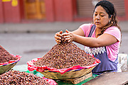 A vendor of spicy grasshoppers called chapulines at the Benito Juarez Market in Oaxaca, Mexico.