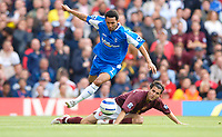 Photo: Henry Browne.<br /> Arsenal v Birmingham City. The Barclays Premiership.<br /> 02/10/2005.<br /> Jermaine Pennant of City skips over a challenge from Cesc fabregas of Arsenal.