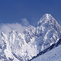 Chamonix, France. Skier skiing in the French Alps with Aiguille du Chardonnet in the background.