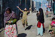 A girl is jumping in the air with her hands towards the sky while playing with a flying toy in New Arif Nagar, one of the water-affected colonies standing next to the abandoned Union Carbide (now DOW Chemical) industrial complex, site of the infamous 1984 gas tragedy in Bhopal, Madhya Pradesh, central India. The poisonous cloud that enveloped Bhopal left everlasting consequences that today continue to consume people's lives.