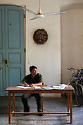 A clerk writes at a desk in his office, Pondicherry, India. Pondicherry now Puducherry is a Union Territory of India and was a French territory until 1954 legally on 16 August 1962.