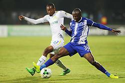 25042018 (Durban)Thapelo Morena tackles with Mxolisi Kunene at a game Mamelodi Sundowns look to edge closer to the Absa Premiership title when lock horns with Maritzburg United at Harry Gwala Stadiumm Pietermaritzburg on Wednesday night.Picture: Motshwari Mofokeng/ANA