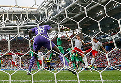 MOSCOW, June 19, 2018  Grzegorz Krychowiak (1st R) of Poland scores a goal during a Group H match between Poland and Senegal at the 2018 FIFA World Cup in Moscow, Russia, June 19, 2018. Senegal won 2-1. (Credit Image: © Cao Can/Xinhua via ZUMA Wire)
