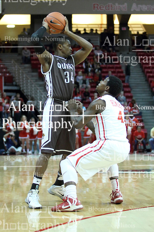 03 November 2013:  Bobby Hunter forces T.J. Riggs to pick up this dribble during an mens exhibition basketball game between the Quincy Hawks and the Illinois State Redbirds in Redbird Arena, Normal IL