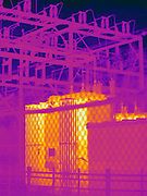 Thermogram of an electrical substation.  The substation houses a number of transformers that convert line voltage into the correct voltage for homes to use. The different colors represent different temperatures on the object. The lightest colors are the hottest temperatures, while the darker colors represent a cooler temperature.  Thermography uses special cameras that can detect light in the far-infrared range of the electromagnetic spectrum (900?14,000 nanometers or 0.9?14 µm) and creates an  image of the objects temperature..
