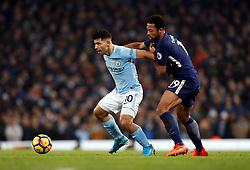 Manchester City's Sergio Aguero (left) and Tottenham Hotspur's Mousa Dembele battle for the ball