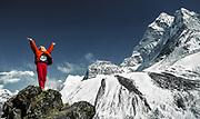 Trekker relishes the beauty of the Khumbu Himal, North Ridge Ama Dablam behind, Sagarmatha National Park, Nepal Himalaya