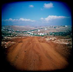 Israeli tank treads are seen near the town of Aytaroun, Southern Lebanon, Oct. 23, 2006.