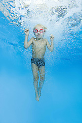 September 18, 2016 - Odessa, Ukraine - 5 years boy in a swimming goggles jumping into swimming pool (Credit Image: © Andrey Nekrasov/ZUMA Wire/ZUMAPRESS.com)