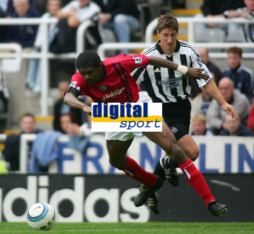 Fotball<br /> England 2004/2005<br /> Foto: SBI/Digitalsport<br /> NORWAY ONLY<br /> <br /> Newcastle United v West Bromich Albion, Barclays Premiership, St James' Park, Newcastle upon Tyne 25/09/2004.<br /> <br /> West Bromwich's Nwanko Kanu (L) is sent flying by Newcastle's Robbie Elliot (R).