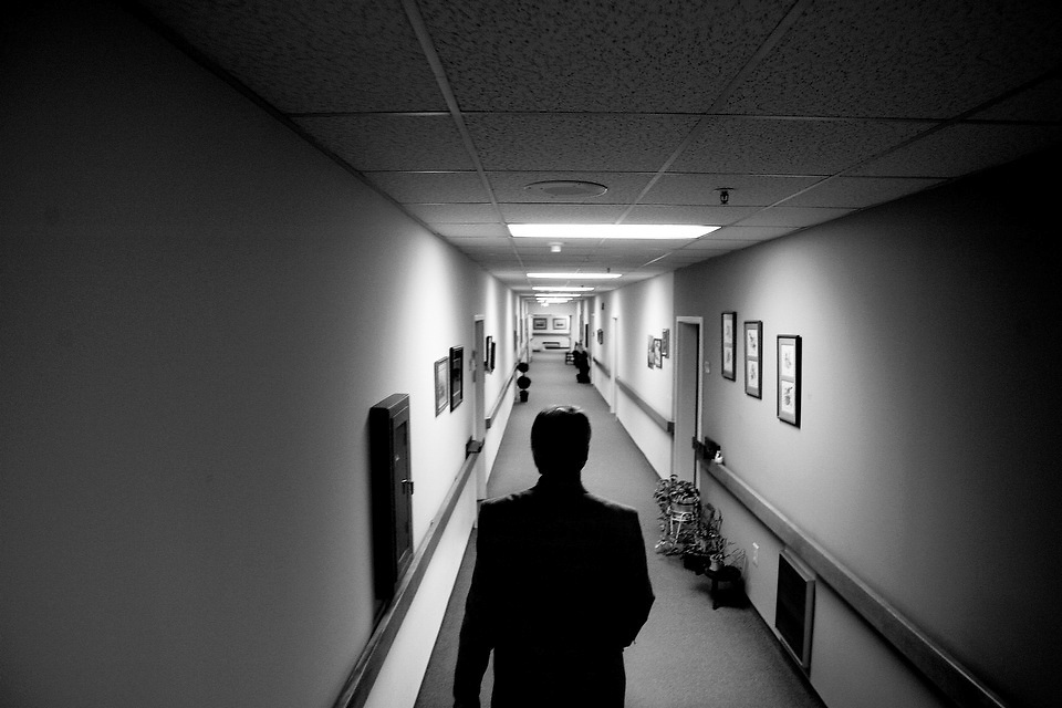 Dr. Dale Hamrick walks the halls at a retirement home in Columbia during a visit with some of his patients.