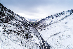 © Licensed to London News Pictures. 03/02/2019 Snowdonia, UK. UK An aerial view of the A487 trunk  road as it winds through Bwlch Llyn Bach and the snowy landscape between Corris and Dolgellau in Snowdonia National Park, Gwynedd, North Wales. <br /> Photo credit: Keith Morris/LNP