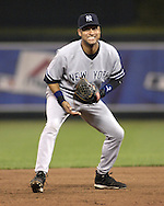 July 26, 2007 - Kansas City, MO..New York Yankees shortstop reacts to a pitch in the seventh inning against the Kansas City Royals at Kauffman Stadium in Kansas City, Missouri on July 26, 2007...MLB:  The Royals defeated the Yankees 7-0.  Photo by Peter G. Aiken / Cal Sport Media