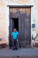 Man and door in Gibara, Holguin, Cuba.