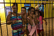 Havana, Cuba. La Habana Vieja (Old Habana). Kids joking with tourists at Hotel Ambos Mundos, where Ernest Hemingway used to stay.