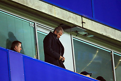 29 November 2017 -  Premier League - Chelsea v Swansea City - Chelsea owner Roman Abramovich struggles with the zip on his coat - Photo: Marc Atkins/Offside
