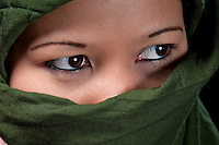 Close up of asiatic woman eyes wrapped in islamic scarf.
