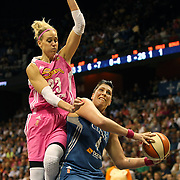 Janel McCarville, (right), Minnesota Lynx, is challenged by Katie Douglas, Connecticut Sun, as she prepares to shoot  during the Connecticut Sun Vs Minnesota Lynx, WNBA regular season game at Mohegan Sun Arena, Uncasville, Connecticut, USA. 27th July 2014. Photo Tim Clayton