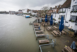 © Licensed to London News Pictures. 05/02/2021. Henley-On-Thames, UK. Tables surrounded by water at a pub in Henley-On-Thames, Oxofrdshire where the River Thames has broken its banks.  Large parts of the UK experience more wet conditions which is expected to bring further flooding. Photo credit: Ben Cawthra/LNP