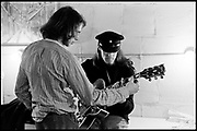"""Fall River, Massachusetts - 18 February 1968. Ian Underwood (left) and Jim """"Motorhead"""" Sherwood of The Mothers of Invention prior to a performance. © 2020 Ed Lefkowicz<br /> <br /> For licensing of any of the images in this portfolio go to https://www.mptvimages.com/<br /> <br /> For fine art prints, get in touch with me directly."""