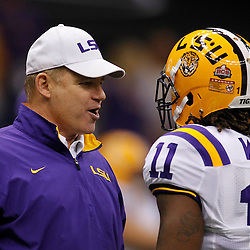 Jan 9, 2012; New Orleans, LA, USA; LSU Tigers head coach Les Miles talks to Spencer Ware (11) before the 2012 BCS National Championship game against the Alabama Crimson Tide at the Mercedes-Benz Superdome.  Mandatory Credit: Derick E. Hingle-US PRESSWIRE