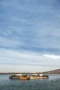 Small family Island, one of the Floating islands of Lake Titicaka, Puno, Peru, South America