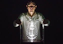 © London News Pictures. 03/02/2017. Luke Jerram with his Malaria glass sculpture. Luke Jerram's Glass Microbiology exhibition on display at At-Bristol. The exhibition showcases eight jewel-like sculptures, showing accurate representations of deadly viruses and microbiology. Photo credit: Brad Wakefield/LNP