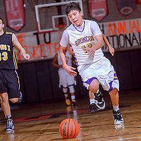 011014       Cable Hoover<br /> <br /> Kirtland Central Bronco Junior Smith (12) sprints up the court ahead of the St. Pius Sartans Friday at Gallup High School.