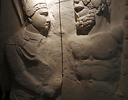 Plaster cast of upper part of a marble relief.  King Antiochus 1 of Commagene clasps the right hand of Hercules.  Original at Nemrud Dagi, south-east Turkey.