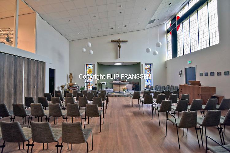 Nederland, Vredepeel, 31-1-2019Repo over de lokale kerk die door het dorp omgebouwd is tot kleinere kerk annex dorpshuis met  multifunctionele zaal en ontmoetingsruimte. De verkleinde kerkruimte .Foto: Flip Franssen
