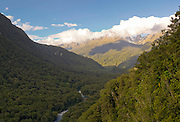 Looking down the Hollyford River Valley from just east of the Homer Tunnel, Highway 94, on the route from Te Anau to Milford Sound, Fiordland National Park, Southland New Zealand