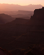 Dawn light and a recession of canyon walls and ledges as Shafer Overlook, Utah. Picture by Andrew Tobin.