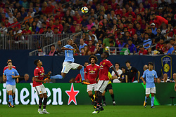 Manchester City defender Vincent Kompany (4) goes up for a ball between Manchester United midfielder Paul Pogba (6) and Manchester United midfielder Jesse Lingard (14) during the International Champions Cup match between Manchester United and Manchester City at NRG Stadium in Houston, Texas