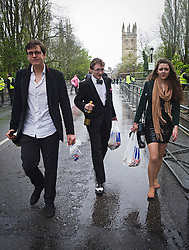 © London News Pictures. 01/05/2012. Oxford, UK. Oxford Brookes students leaving  May Day celebrations on Magdalen Bridge in Oxford on May 1, 2012. Revelers where prevented from jumping from the bridge, which is tradition on May Day, due to safety risks. Photo credit : LNP