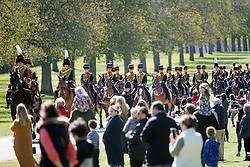 © Licensed to London News Pictures. 17/04/2021. Windsor, UK. Members of the Kings Troop Royal Artillery make their way along The Long Walk to Windsor Castle, in Windsor, Berkshire, ahead of the funeral of Prince Philip, The Duke of Edinburgh. Prince Philip, the Consort of the longest reigning English monarch in history, Queen Elizabeth II, died on 9 April 2021, two months before his 100th birthday. . Photo credit: Ben Cawthra/LNP