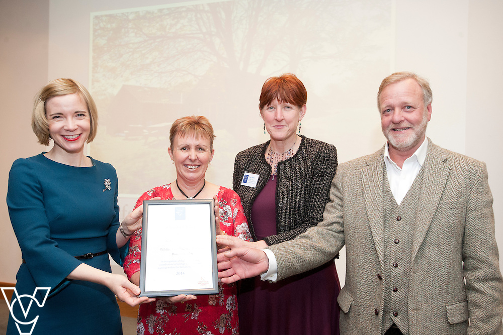Chief curator of the Historic Royal Palaces, Dr Lucy Worsley presents an award to representatives from Wildlife Trust Countryside Centre, Ramsey Heights <br /> <br /> Sandford Awards 2014 ceremony held at the National Maritime Museum, Greenwich.<br /> Date: December 5, 2014<br /> <br /> Picture: Chris Vaughan/Chris Vaughan Photography
