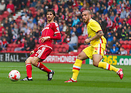 Diego Fabbrini (Middlesbrough FC) in action watched by Samir Carruthers (Milton Keynes Dons) during the Sky Bet Championship match between Middlesbrough and Milton Keynes Dons at the Riverside Stadium, Middlesbrough, England on 12 September 2015. Photo by George Ledger.
