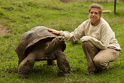 Chelsea Williams, a zookeeper at the Oakland Zoo, poses for a photograph with one of the zoo's giant tortoises, Tuesday, Oct. 23, 2012 in Oakland, Calif. Williams, an Oakland native who attended UC-Santa Cruz, has been a keeper at the zoo for three years, caring for animals as varied as baboons, bats and river otters. (D. Ross Cameron/Staff)