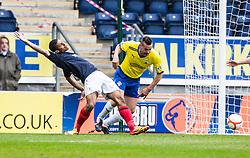 Falkirk's Lyle Taylor held by Morton's Mark McLaughlin..Falkirk 4 v 1 Morton, 4/5/2013..© Michael Schofield..