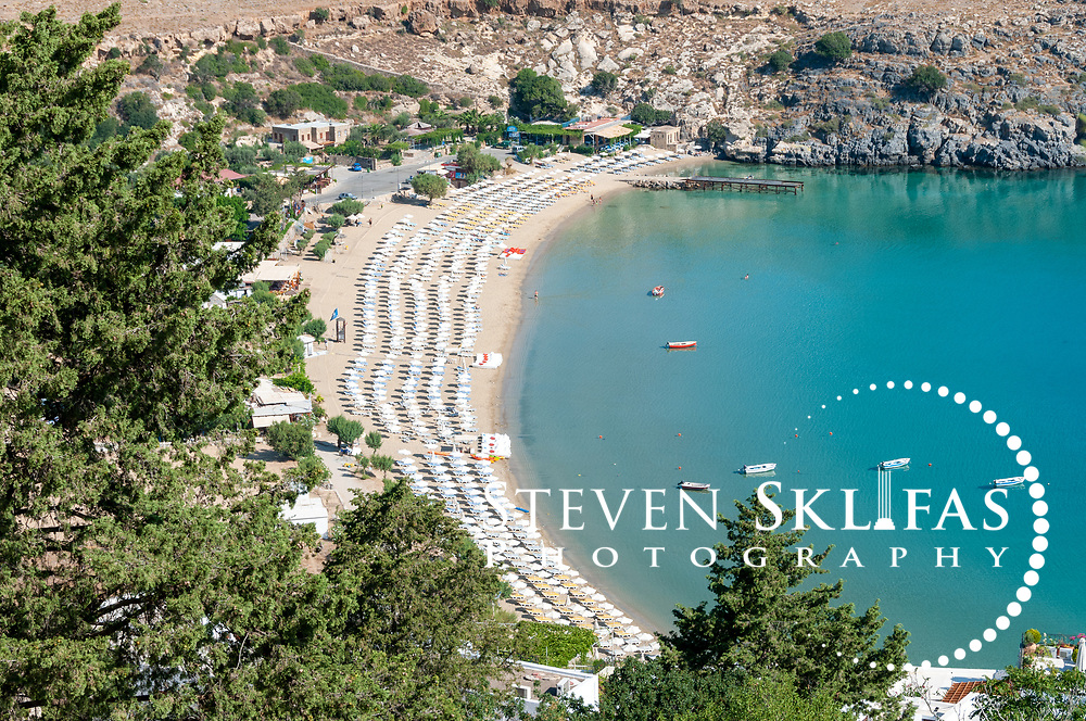 Rhodes. Greece. View from the 114 metre high acropolis of the popular main beach of Lindos called Megalos Gialos at Lindos bay which is where the ancient Lindian fleet once anchored