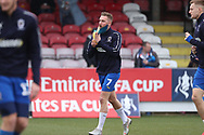 AFC Wimbledon midfielder Scott Wagstaff (7) warming up during the The FA Cup 5th round match between AFC Wimbledon and Millwall at the Cherry Red Records Stadium, Kingston, England on 16 February 2019.