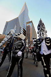 09 February 2016. New Orleans, Louisiana.<br /> Mardi Gras Day. Walking with Skeletons in the Central Business District. The Skeleton Krewe meet before sunrise and walk 5 miles from Uptown, making their way along St Charles Avenue and into the French Quarter where they celebrate Mardi Gras Day.<br /> Photo©; Charlie Varley/varleypix.com