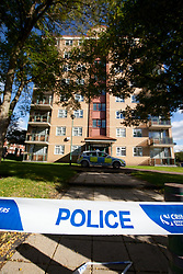 © Licensed to London News Pictures. 06/10/2012. Walsall , UK . GV general view of the scene . Police and forensic examiners investigate after two bodies were found at a block of flats . A woman was found inside a flat in Holly Court , Acacia Avenue , Walsall and a man was found dead outside the block . Photo credit : Joel Goodman/LNP